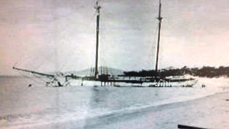 Old black and white photo of the Annie Taylor shipwreck at Rheban Beach.